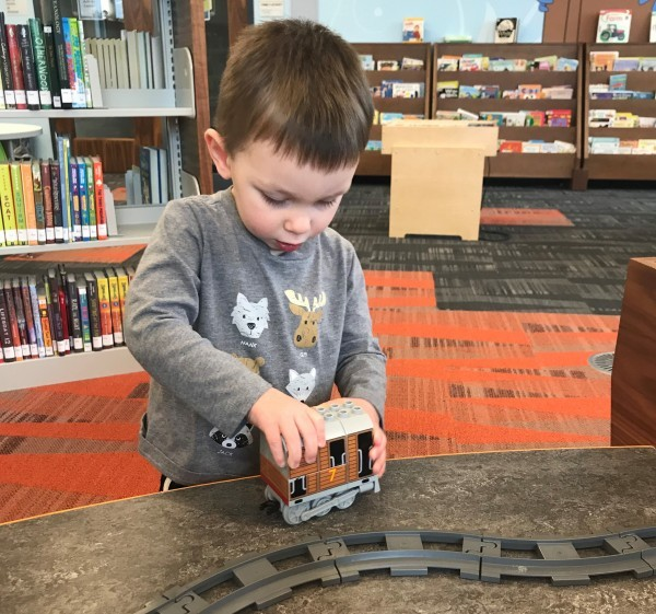 Owen Anderson playing trains