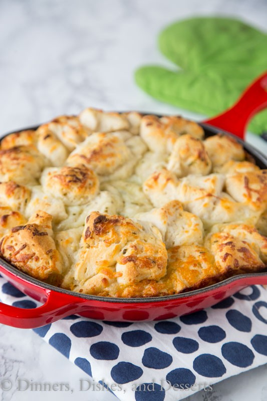 Italian Cheese Pull Apart Bread - make this easy side dish any night of the week. Open a can of biscuits, toss with butter, seasonings, cheese and bake!