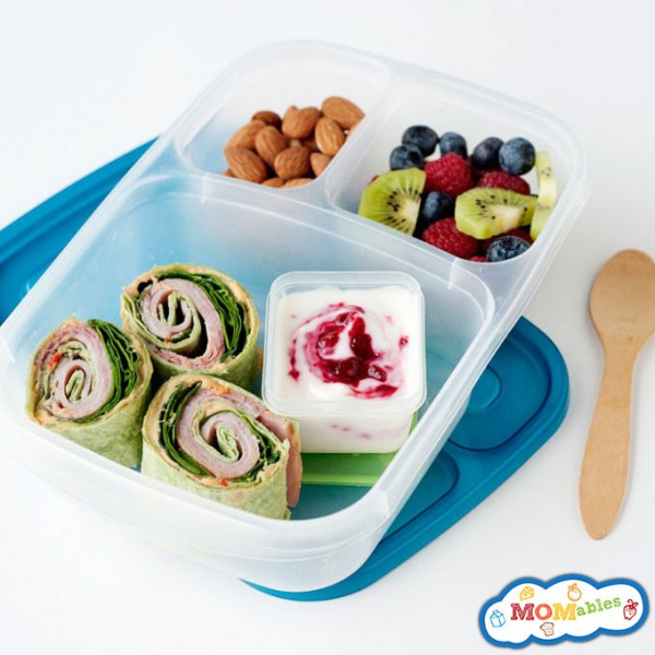 turkey and hummus pinwheels with yogurt, almonds and fruit salad
