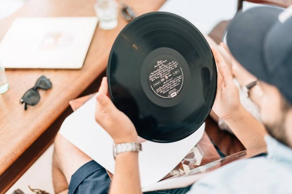 Guy holding record