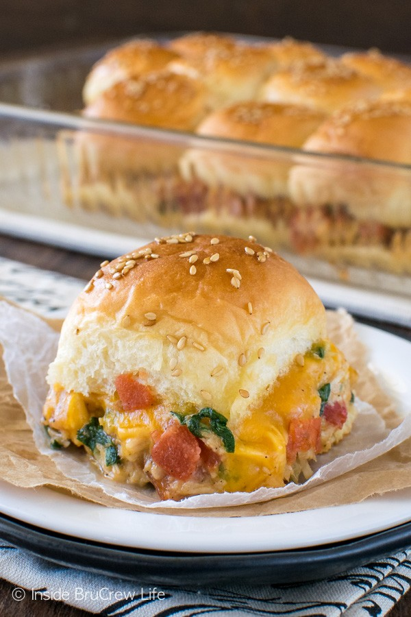Veggies, meat, & cheese give these Cheesy Chicken Sliders an amazing taste. Easy recipe for dinner or game nights!