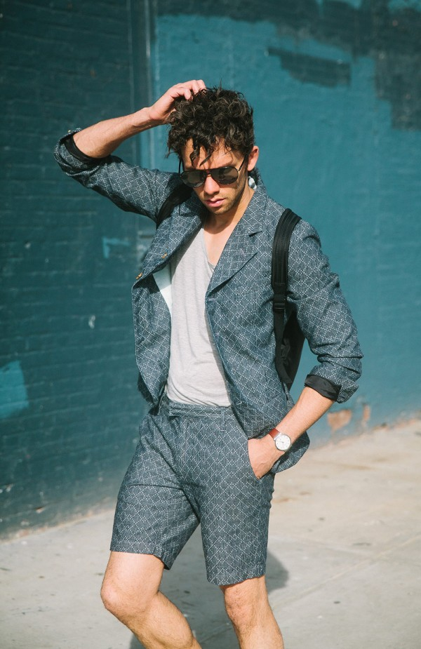 Matiere blue schoolboy suit on with a gray tank and aviator sunglasses