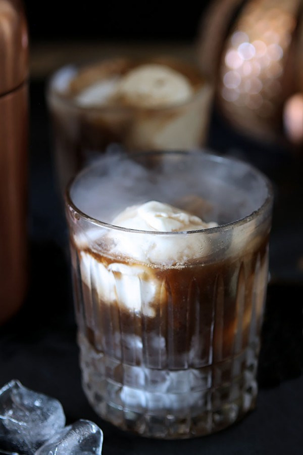 Ghost in the Graveyard Cocktail - Black Vodka, Coffee Liqueur and Vanilla Ice Cream over Dry Ice