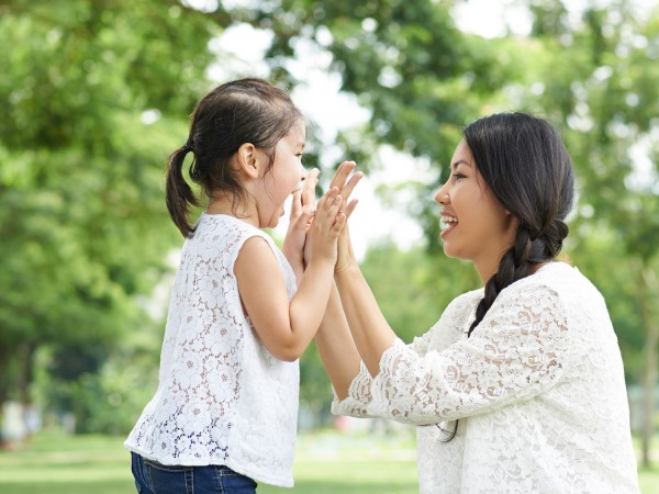 mom daughter high five