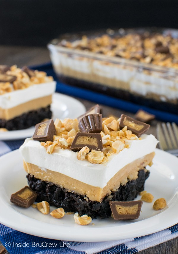 Layers of peanut butter and pudding give this Peanut Butter Brownie Dessert a fun and sweet flair! Great dessert recipe!