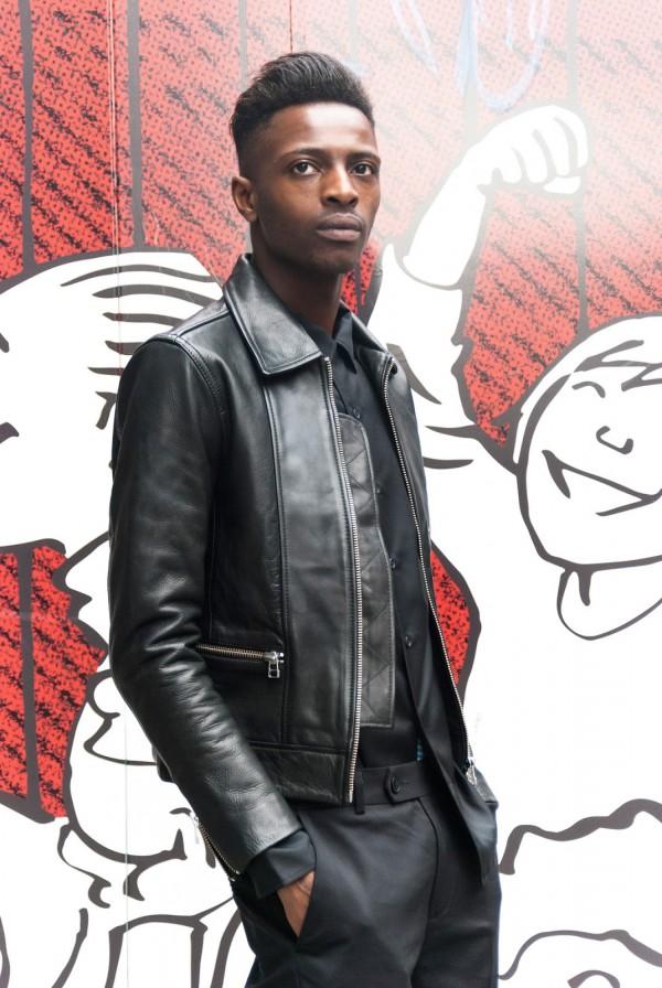 urban street fashion black male wearing biker leather jacket black pants box haircut