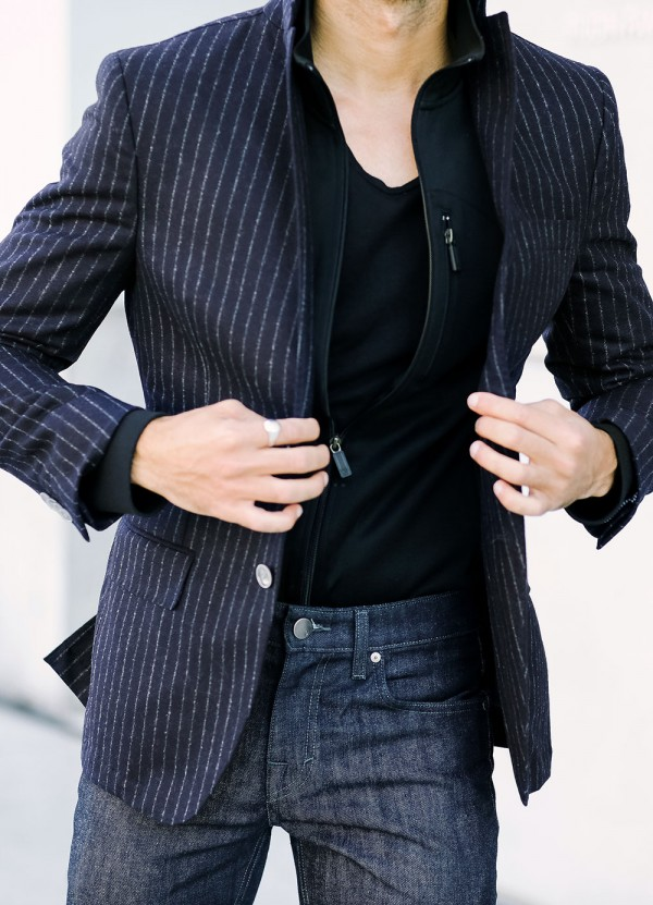 Menswear outfit: chalk stripe blazer with a track jacket and jeans