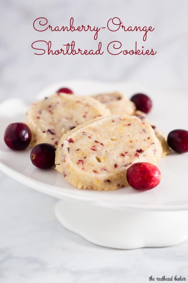 Shortbread cookies are a Scottish Christmas tradition. This version of the crumbly cookie is flavored with dried cranberries and orange zest. #IntnlCookies