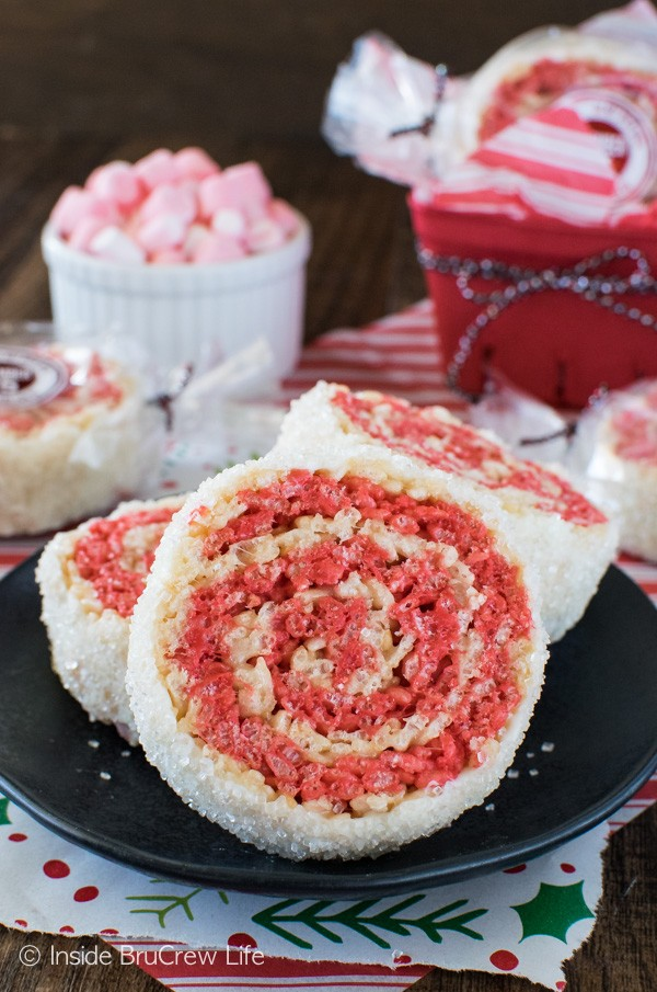These easy no bake Peppermint Rice Krispies Pinwheels have swirls of color and a white chocolate sugar coating. Fun recipe for holiday parties!