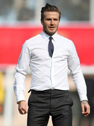 David Beckham sporting a tucked in tie