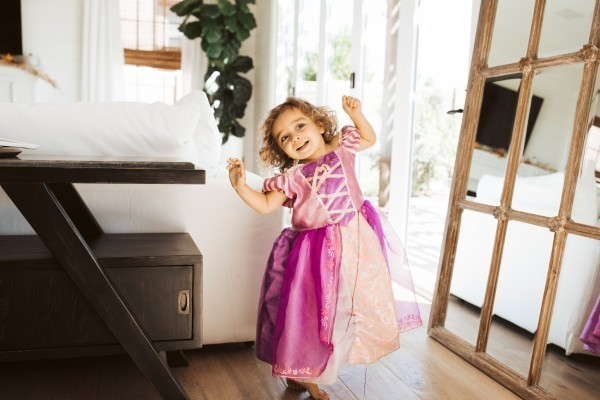 toddler playing in a dress