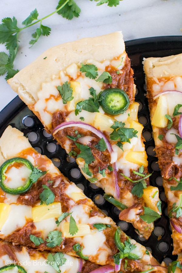 BBQ Pork Pineapple Pizza - this easy grilled pizza has a sweet and spicy combo that will have you reaching for more. Great summer dinner recipe! #99DaysofBBQ #sponsored