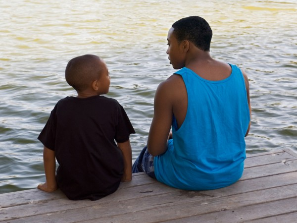Father and Son Sitting by Water