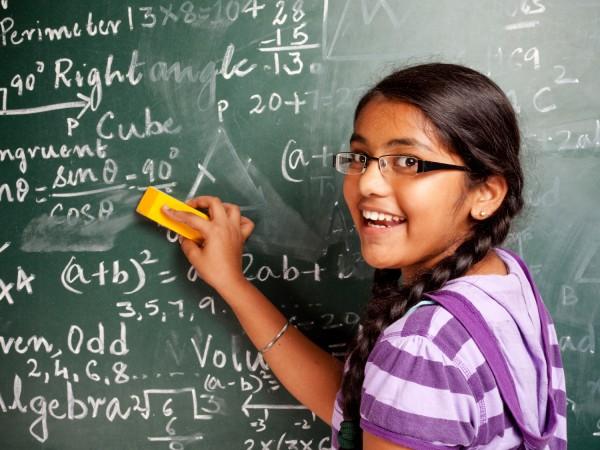 Girl Erasing Chalkboard