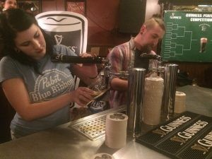 Bartenders Bonnie Westerfield and Tony Argento battle to pour the perfect pint, photo by Sara Havens