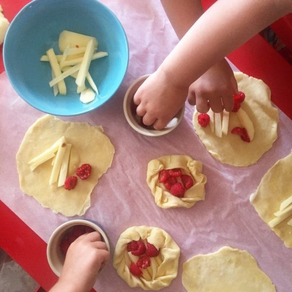 Kids making fruit galettes on eatlivetravelwrite.com