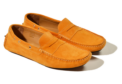 A pair of apricot suede loafers