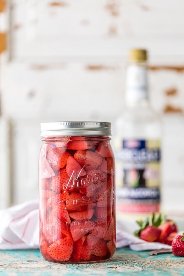You can make HOMEMADE STRAWBERRY SHORTCAKE VODKA at home! SO easy and tastes amazing! Perfect with SPIKED STRAWBERRY SHORTCAKE ICE CREAM FLOATS! The ultimate Summer treat.