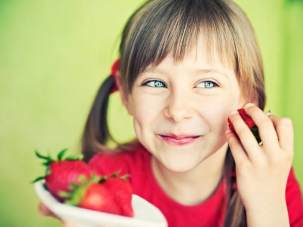 Girl Eating Strawberrys