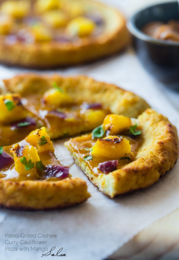 Mango Curry Cashew Paleo Pizza - This pizza is made with a cauliflower crust, topped with creamy, spicy cashew sauce and sweet mango! It's a healthy gluten, grain and dairy free alternative for pizza night! | Foodfaithfitness.com | @FoodFaithFit