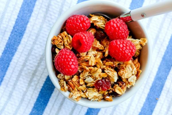 Bowl of granola with raspberries on eatlivetravelwrite.com