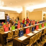 Rainbow of gift bags awaiting seminar attendees at Grape Escape- Peru's Pisco Varietals, photo Peru Trade Commission of Miami