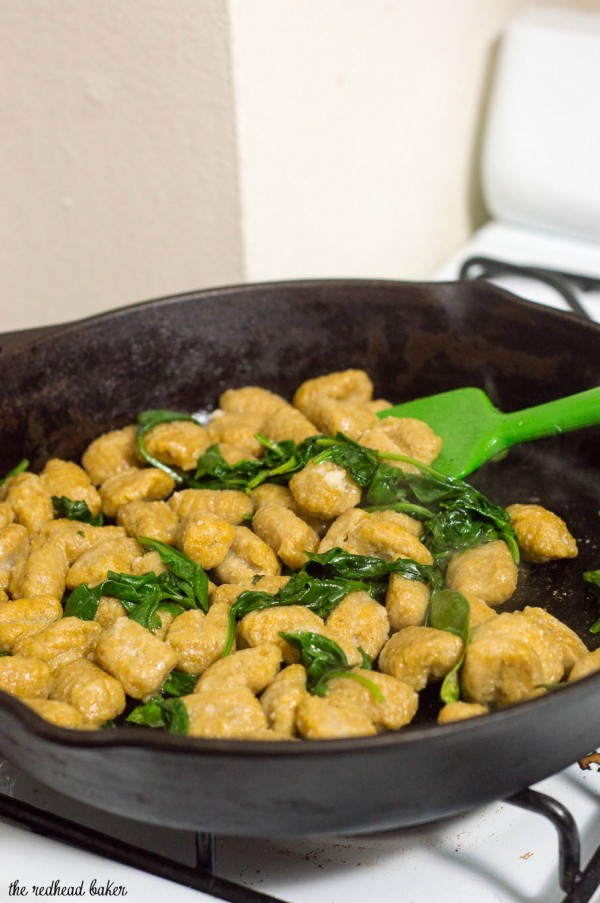 Pumpkin gnocchi and spinach with sage brown butter sauce is a hearty vegetarian meal full of flavor. You won't miss the meat! #SundaySupper