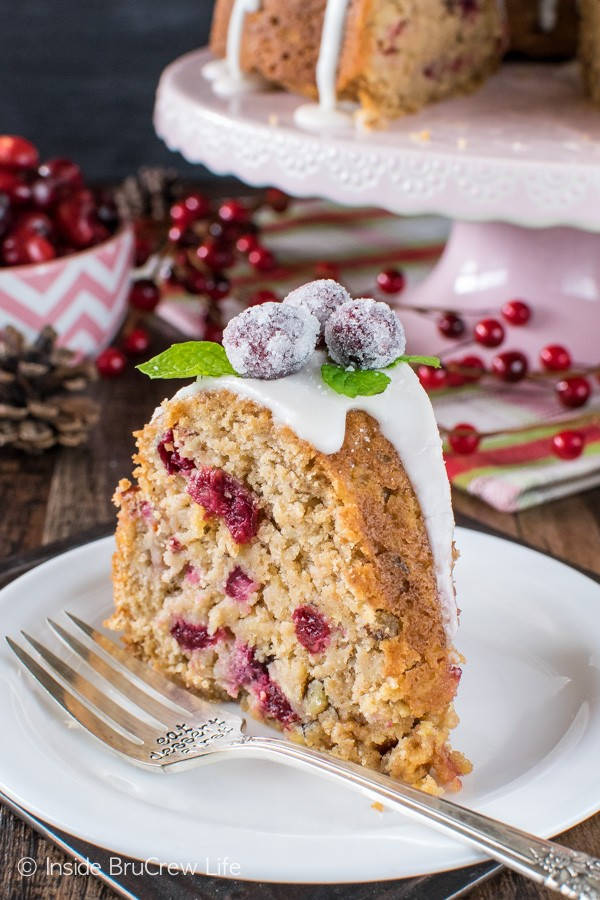 Apple Cranberry Bundt Cake - a sweet glaze & cranberries add a fun festive flair to this easy apple cake. Great recipe for holiday parties!