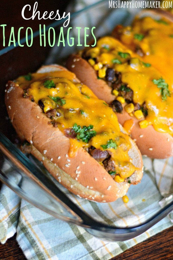 Cheesy Taco Hoagies – the most perfect (and I do mean perfect) taco filling piled high in a hoagie roll, generously topped with cheddar cheese, & baked. The ultimate easy weeknight meal! | MrsHappyHomemaker.com @thathousewife