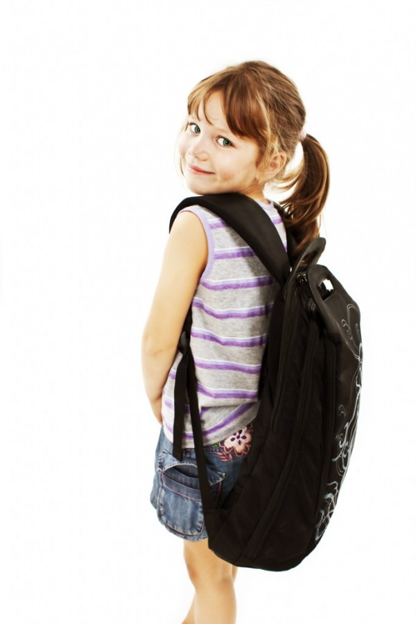 Little girl with big backpack