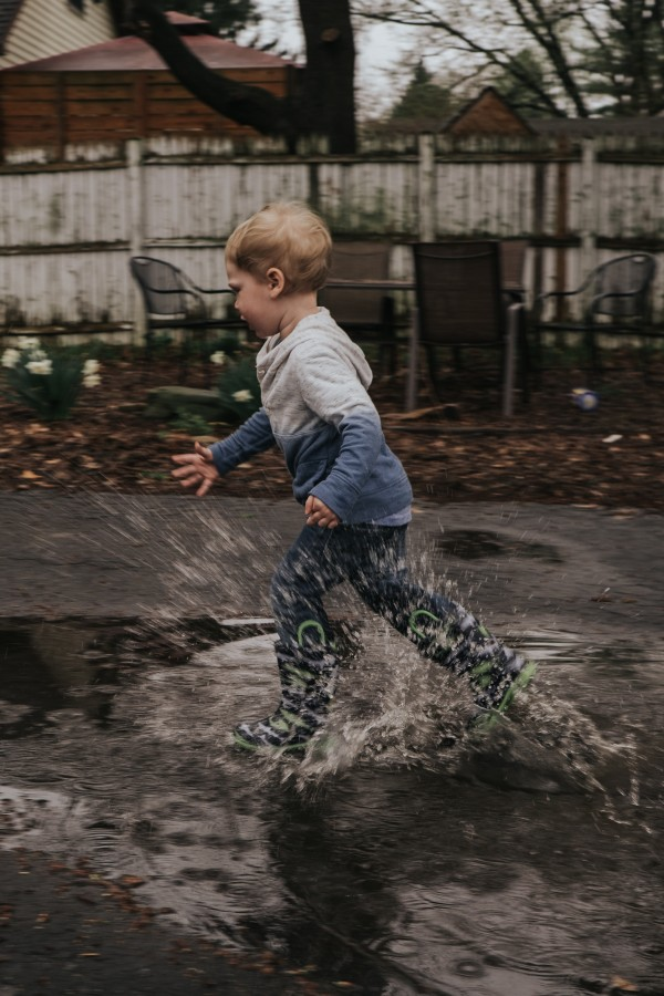 Toddler Runs in Puddle