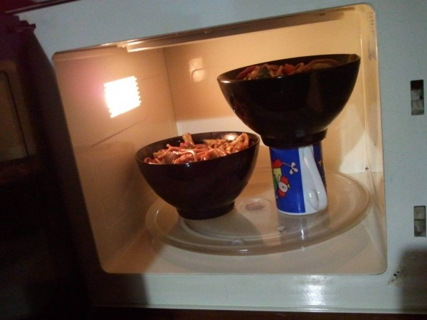 Optimize your microwave space with a coffee mug.