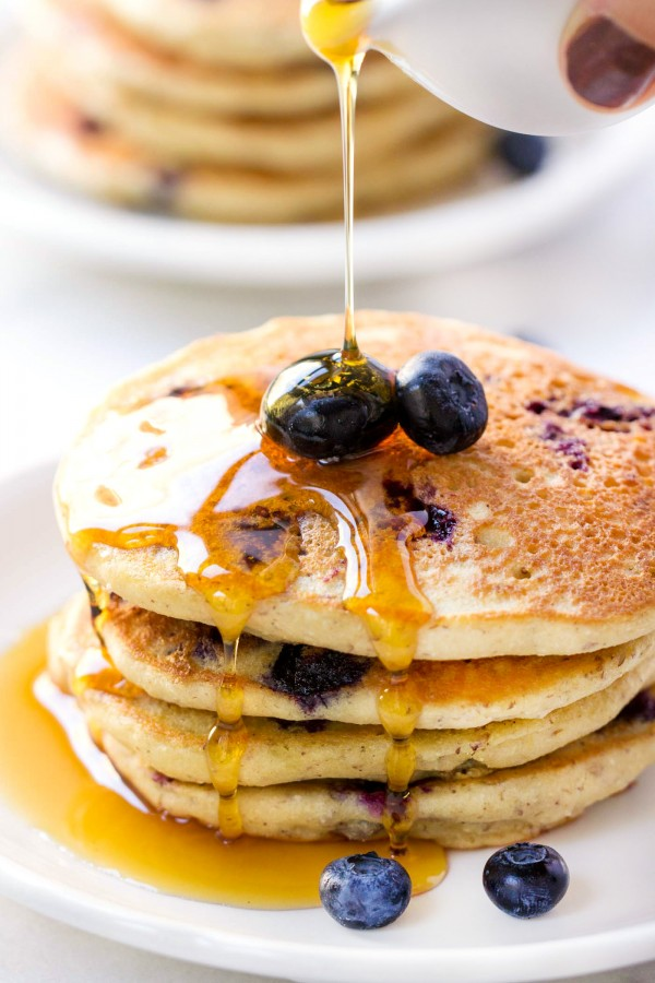 Love these fluffy QUINOA PANCAKES studded with fresh blueberries and drizzled in warm maple syrup. They're the ULTIMATE breakfast treat!