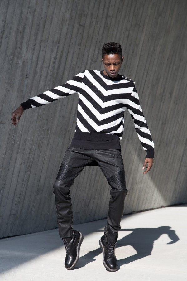 Introducing you Balmain x H&M men's collection + street style guide for Balmain x H&M men's collection written by jonthegold / photography by HOYmedia ( antwerp )  wearing striped sweater  and black leather biker pants and filippa k boots