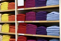 Sweaters on shelf