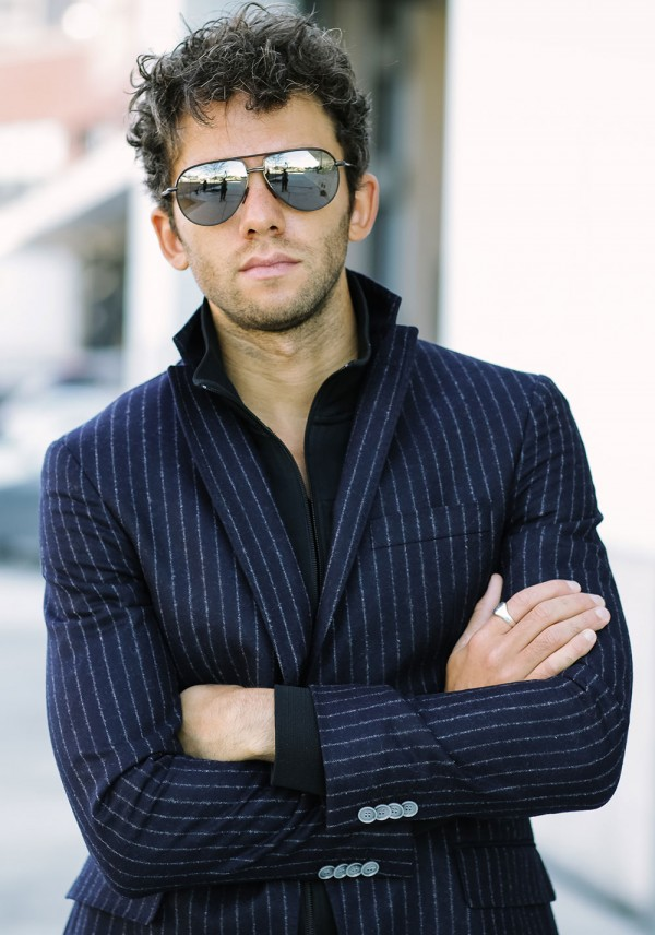 Talun Zeitoun wearing a chalk stripe blazer and track jacket
