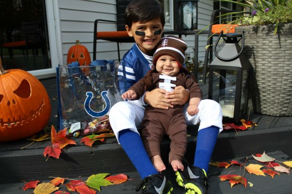 Colts football player and baby football