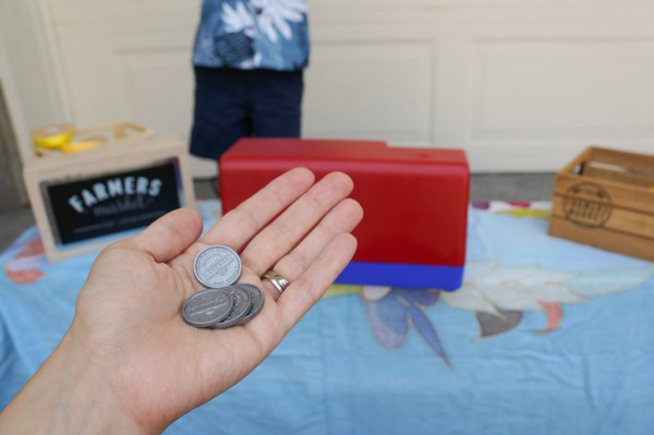 We've been talking a lot about money through imaginative play.