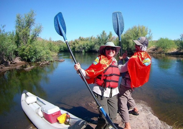 Lisa and Ben as super heros kayaking Salt River