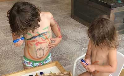 social distancing with kids painting bodies with finger paint