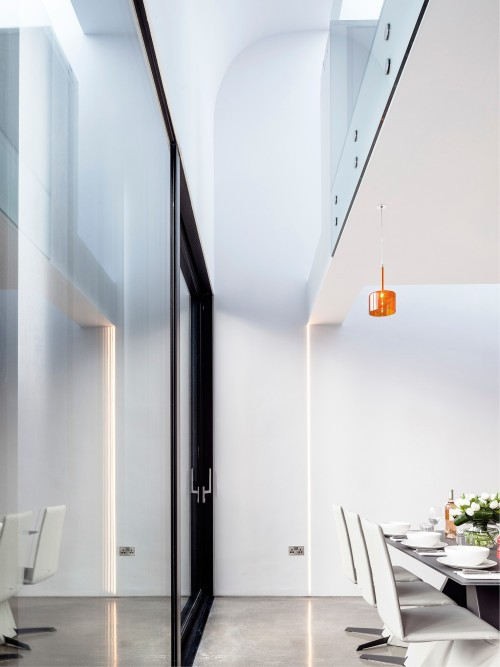 Percy Lane Mews is a minimalist house located in Dublin, Ireland, designed by ODOS architects. (13)