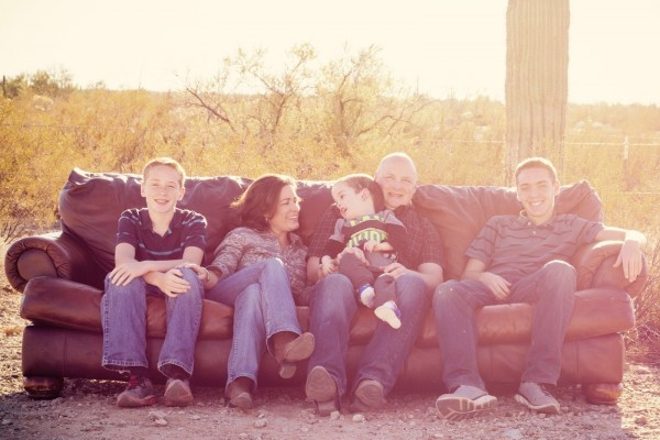 Our family on a couch in the desert. Austin and I looking at each other.