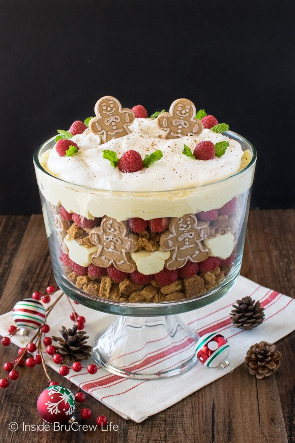 No Bake Eggnog Cheesecake Trifle - this easy cheesecake dessert has layers of cookies, berries, & cheesecake. Great recipe for holiday parties!