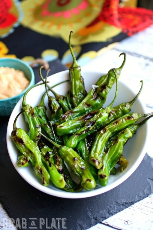 Indulge in an easy-to-make appetizer: Blistered Shishito Peppers with Smoky Paprika Aioli