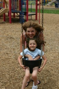 with-ellie-on-the-swing-200x300.jpg