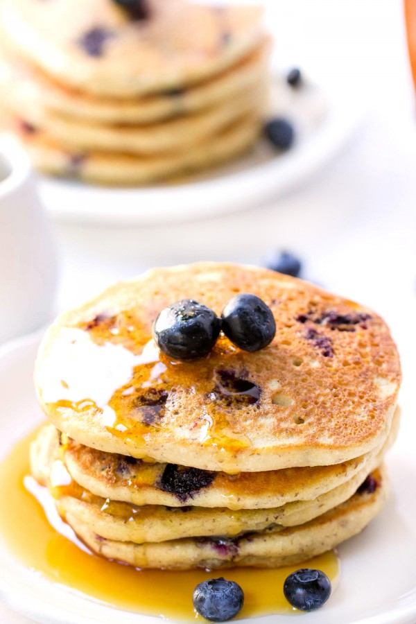 The FLUFFIEST Blueberry Quinoa Pancakes ever. Vegan, gluten-free + with a secret ingredient that give them an AMAZING texture!