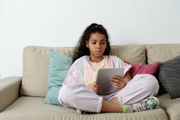 Girl in Pink Shirt on Tablet