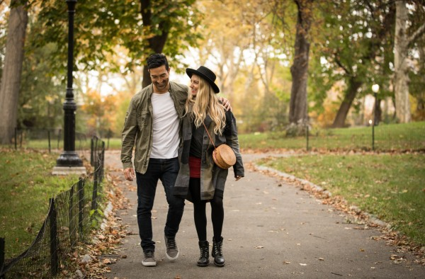 couple walking through park