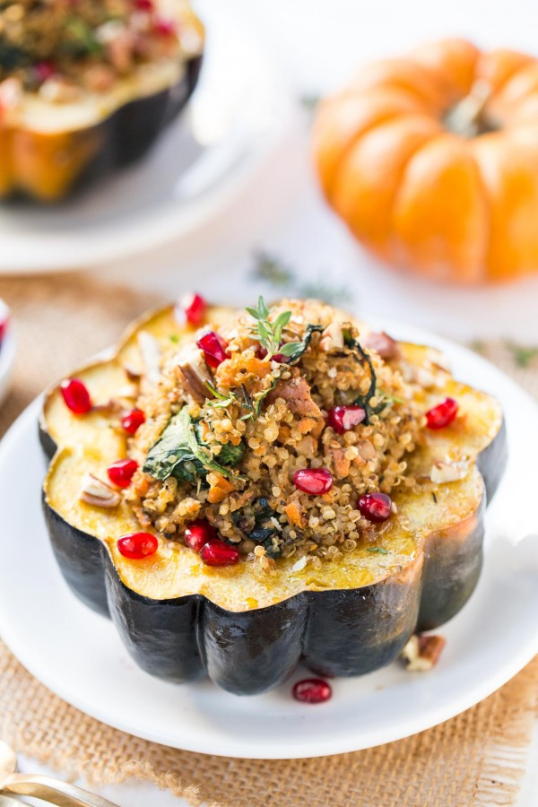 This super easy Quinoa Stuffed Acorn Squash recipe has a delicious plant-based filling using mushrooms, carrots, spinach and pecans!