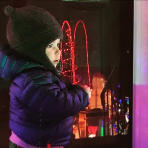 toddler looking at lights